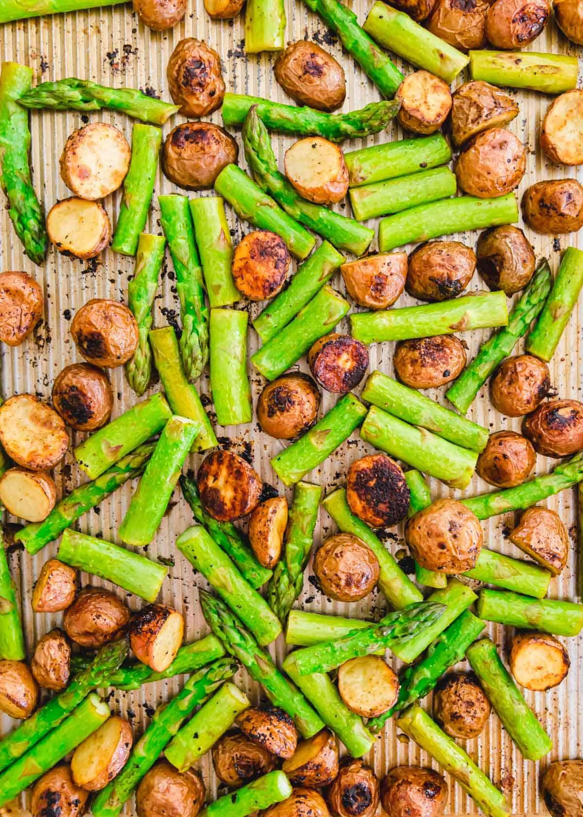 sheet pan roasted red potatoes and asparagus with balsamic and garlic seasoning.