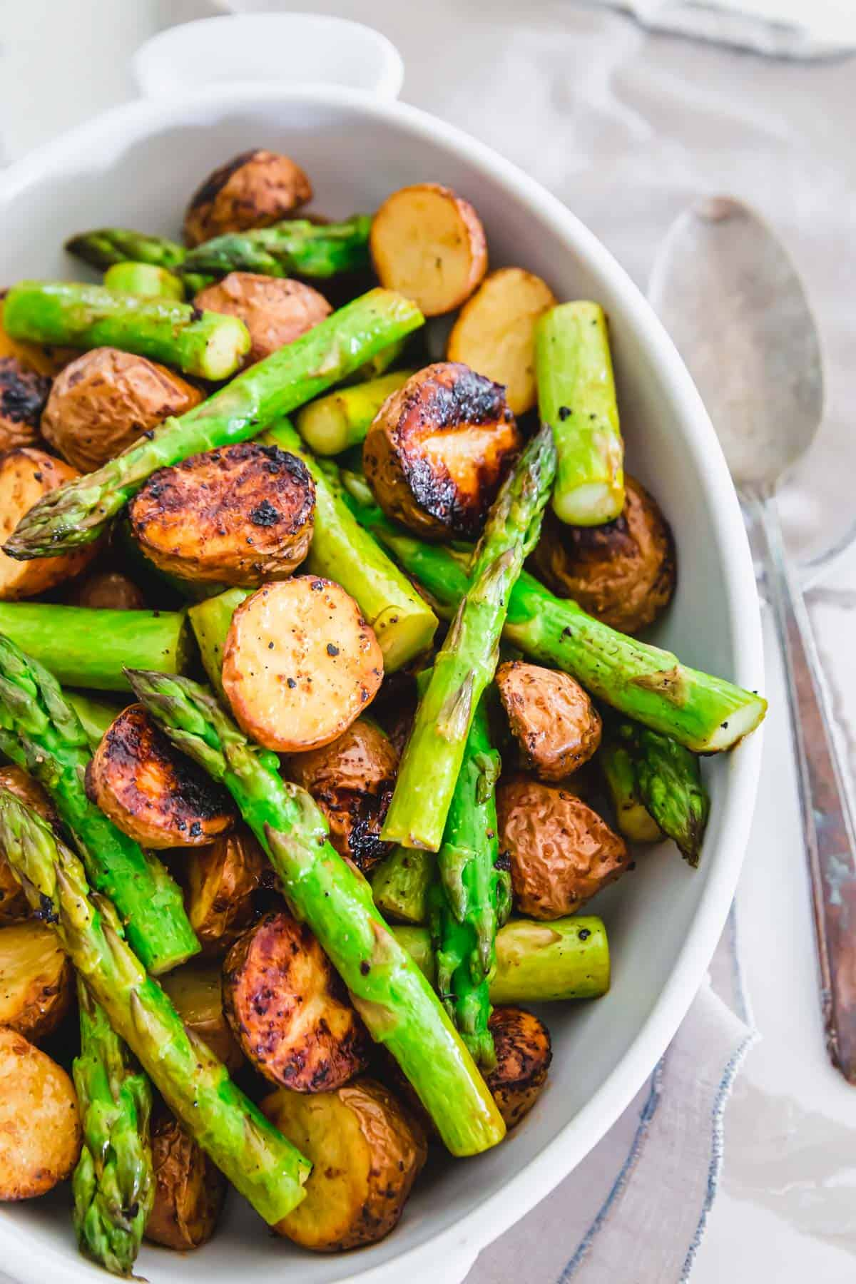 Crispy roasted potatoes and asparagus with garlic balsamic
