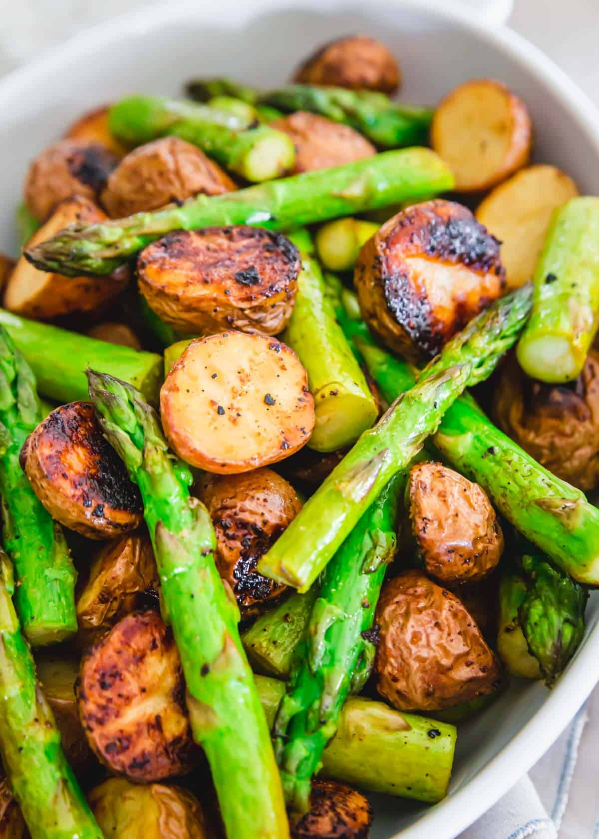 side dish of roasted potatoes and asparagus with garlic balsamic seasoning
