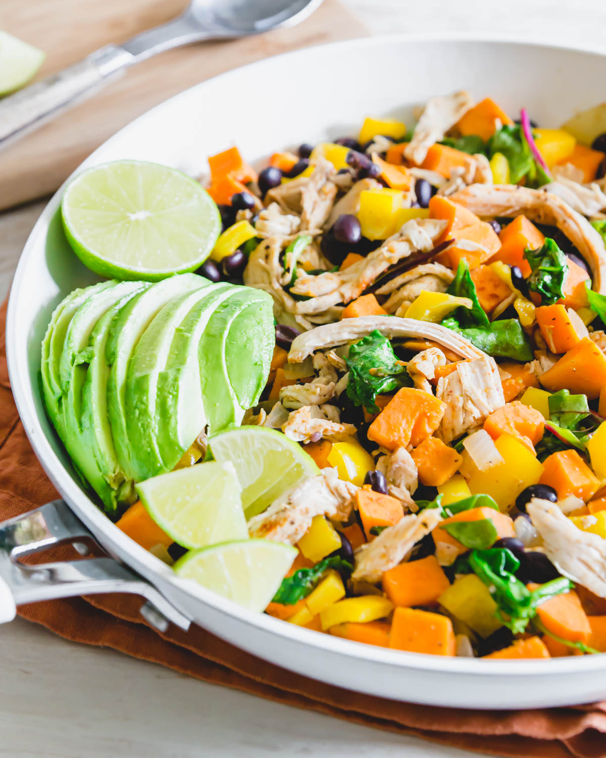 This turkey sweet potato skillet is a healthy way to repurpose leftover turkey (or chicken) with sweet potatoes, black beans, peppers, greens and onions.
