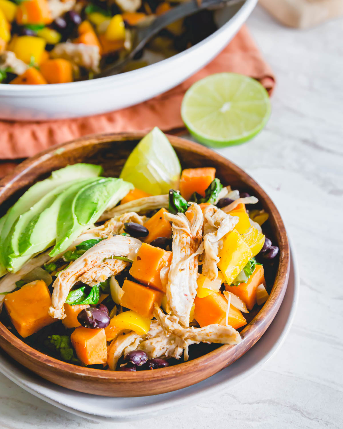 This easy turkey sweet potato skillet comes together in just about 20 minutes in one pan. Served with lime wedges and avocado slices.