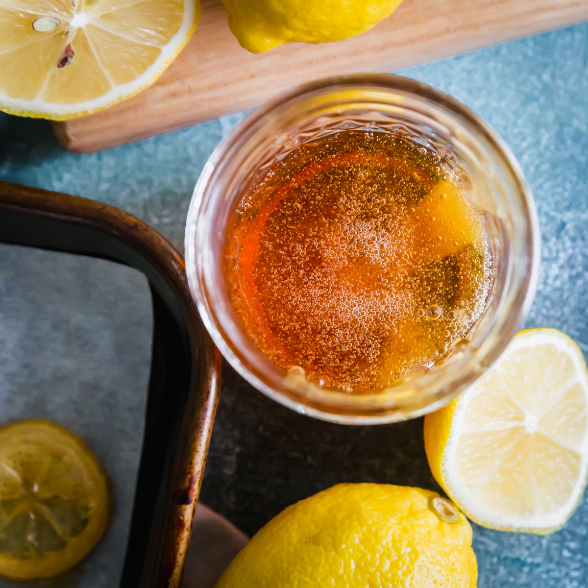 Leftover lemon flavored simple syrup from making candied lemon slices can be jarred and saved for future use!