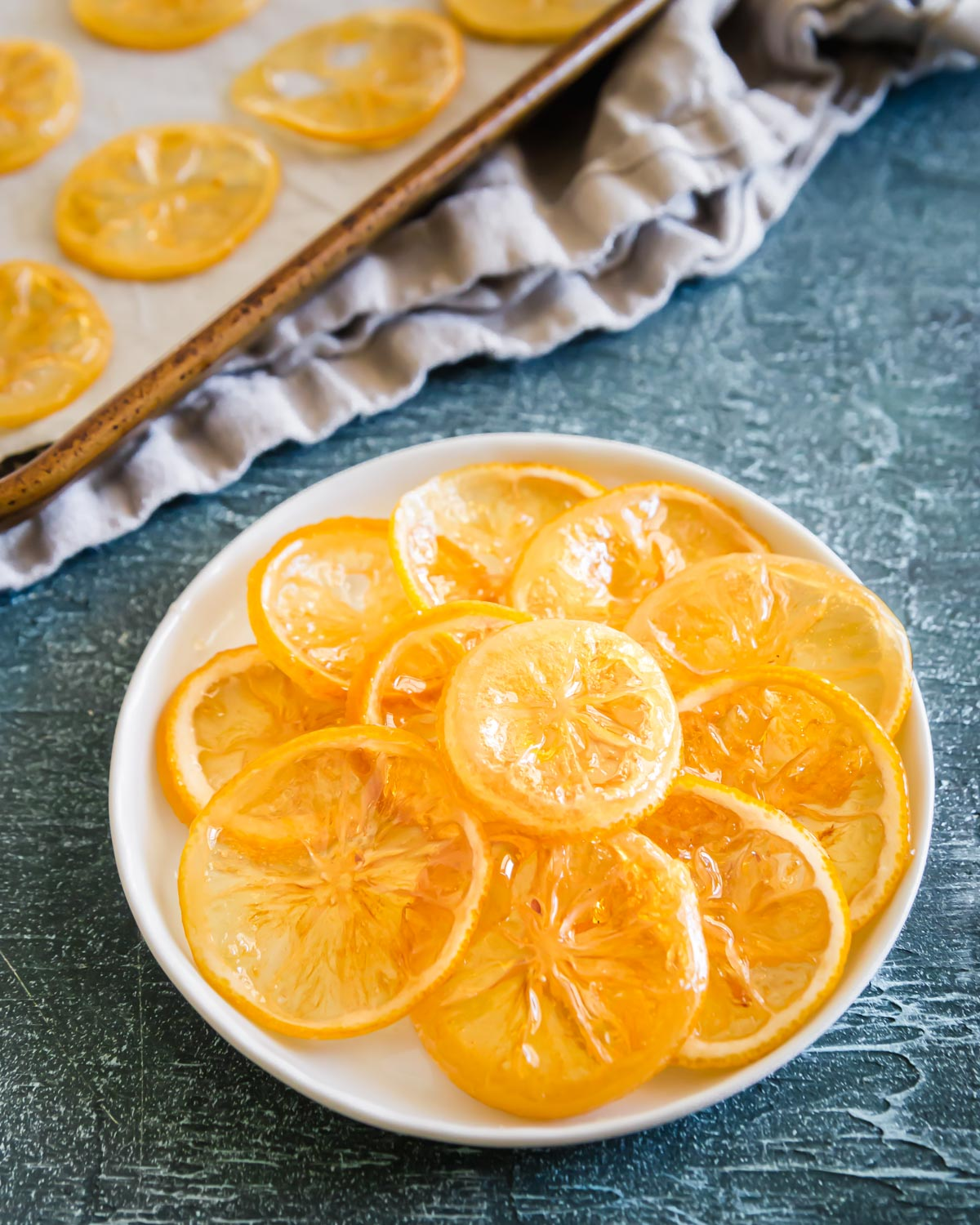 Sweet and tart candied lemon slices are the perfect dessert garnish or addition to festive baking recipes.