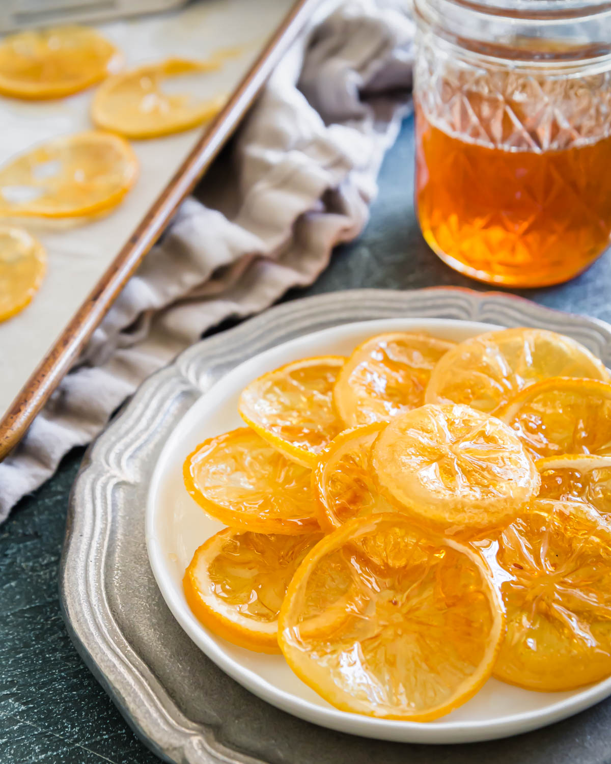 Learn how to easily make candied lemon slices with just 3 ingredients. This simple method can be applied to any citrus fruit.