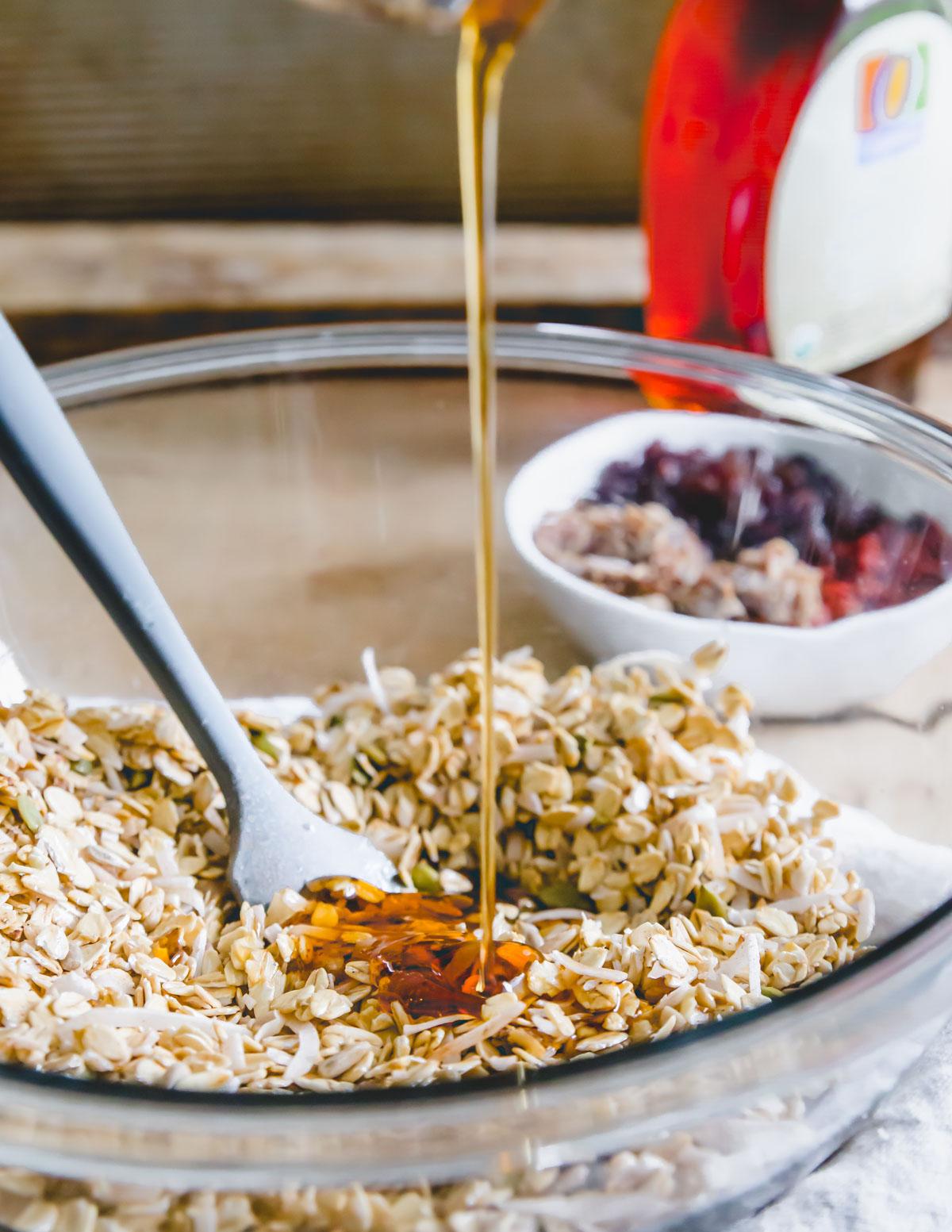 making nut free granola using gluten-free oats, coconut flakes, pepitas, sunflower seeds and buckwheat groats