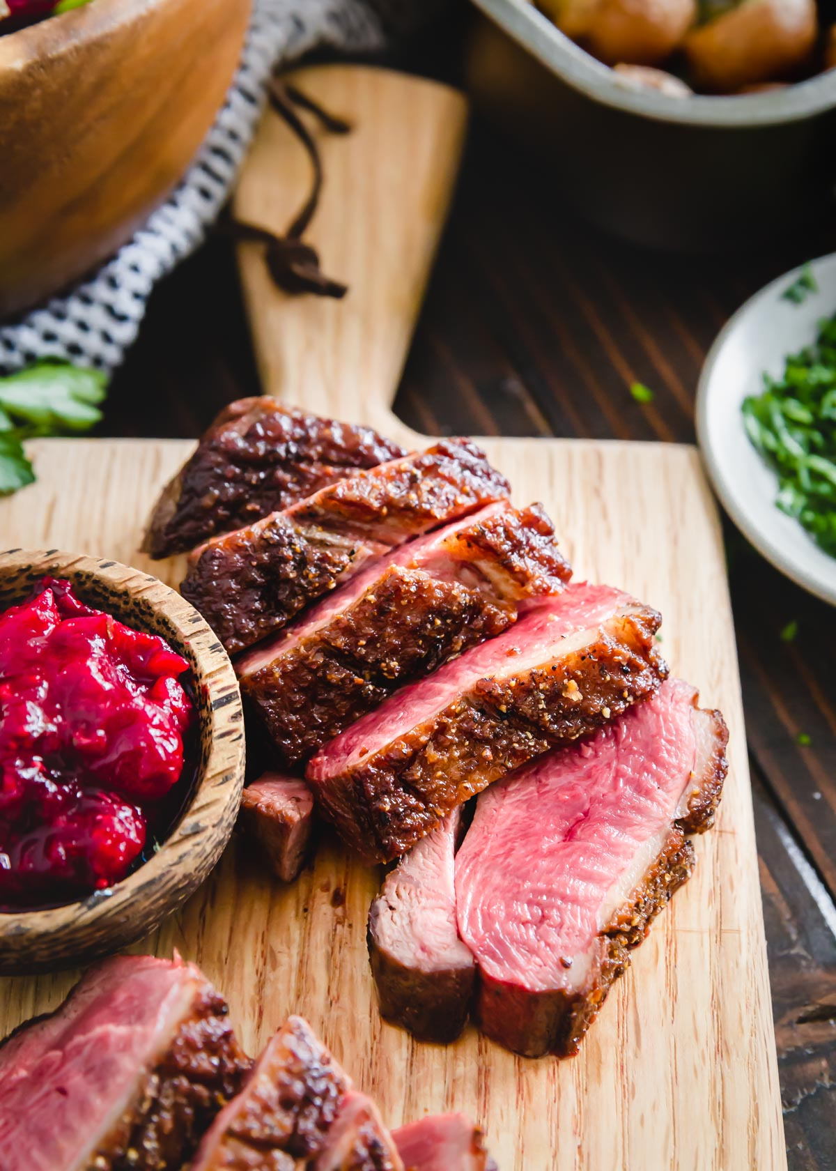 This duck breast recipe comes together so easily with just a few simple ingredients using a quick pan sear method on the stove top. Learn how to cook duck breast with this impressively elegant yet effortless recipe. Perfect for a special dinner at home or to serve a crowd!
