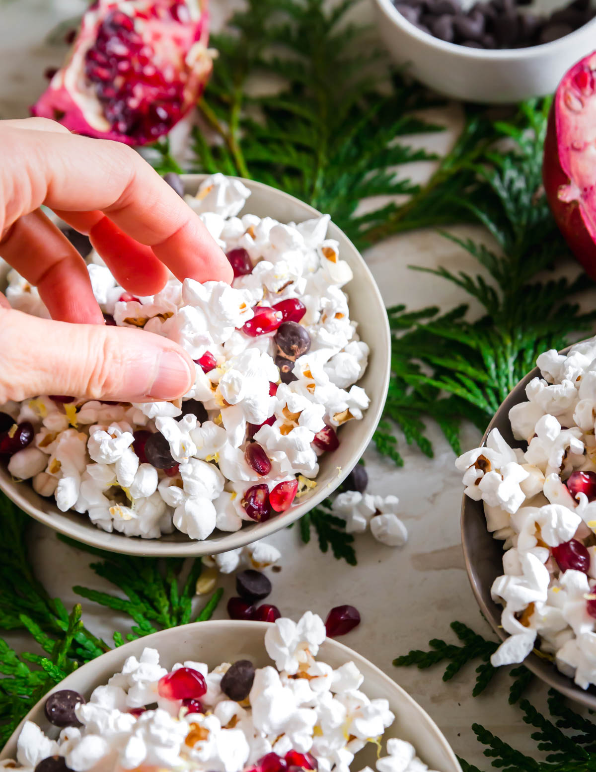 Give your popcorn snack a nutritious boost with some fresh pomegranate arils and lemon zest and a handful of chocolate chips for a bit of decadence!