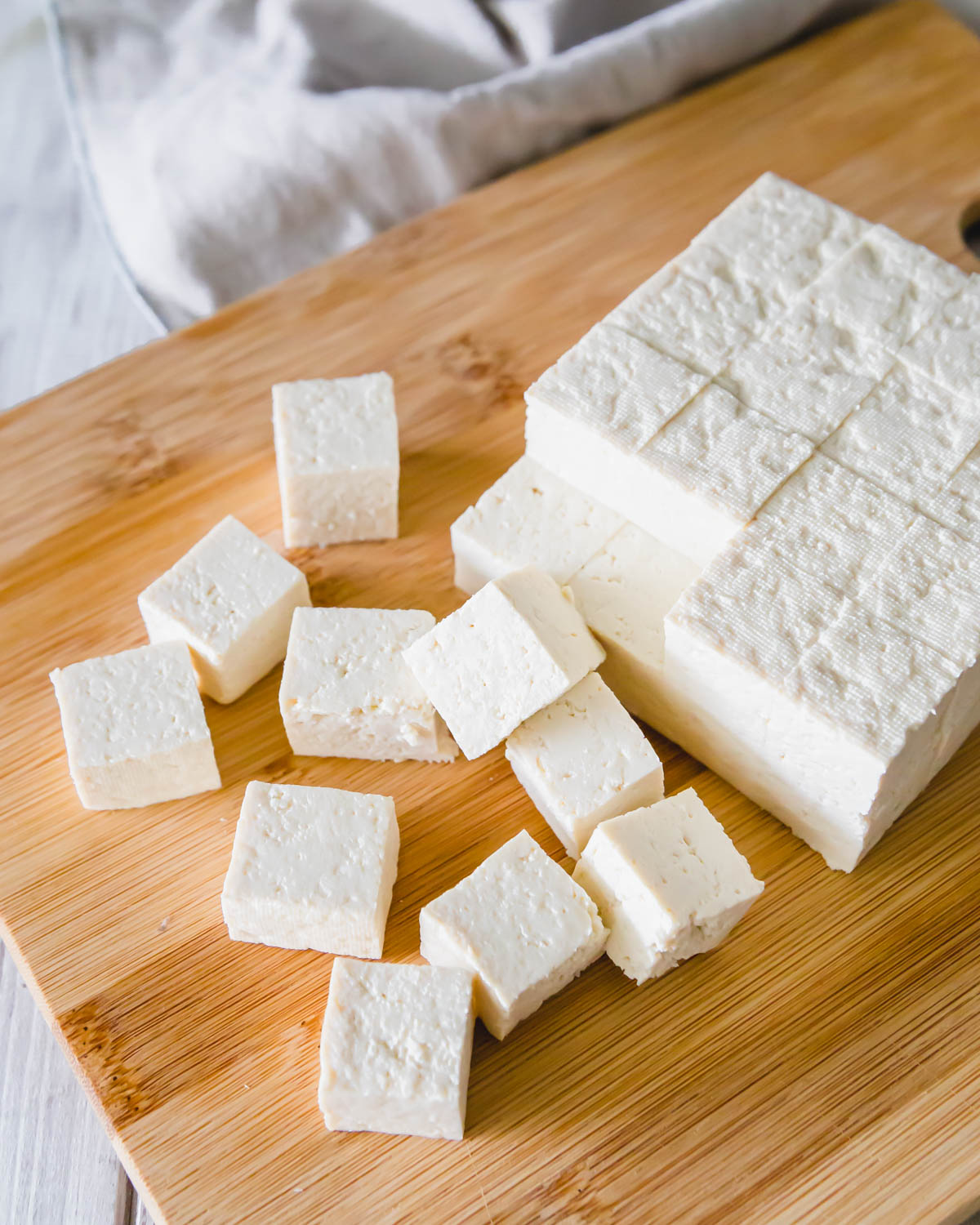 Extra firm tofu, pressed, cut into cubes and ready to be air fried.