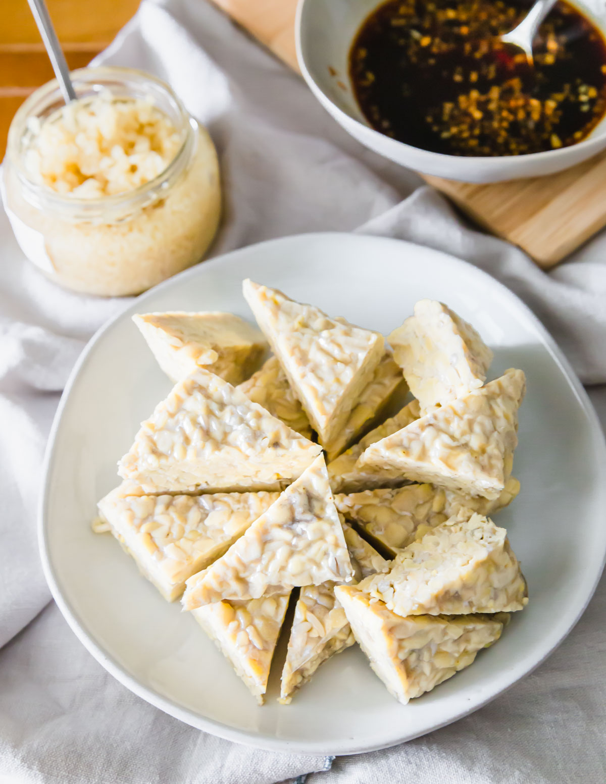 Tempeh triangles ready to be marinated in tamari, maple syrup, balsamic, oil and garlic.