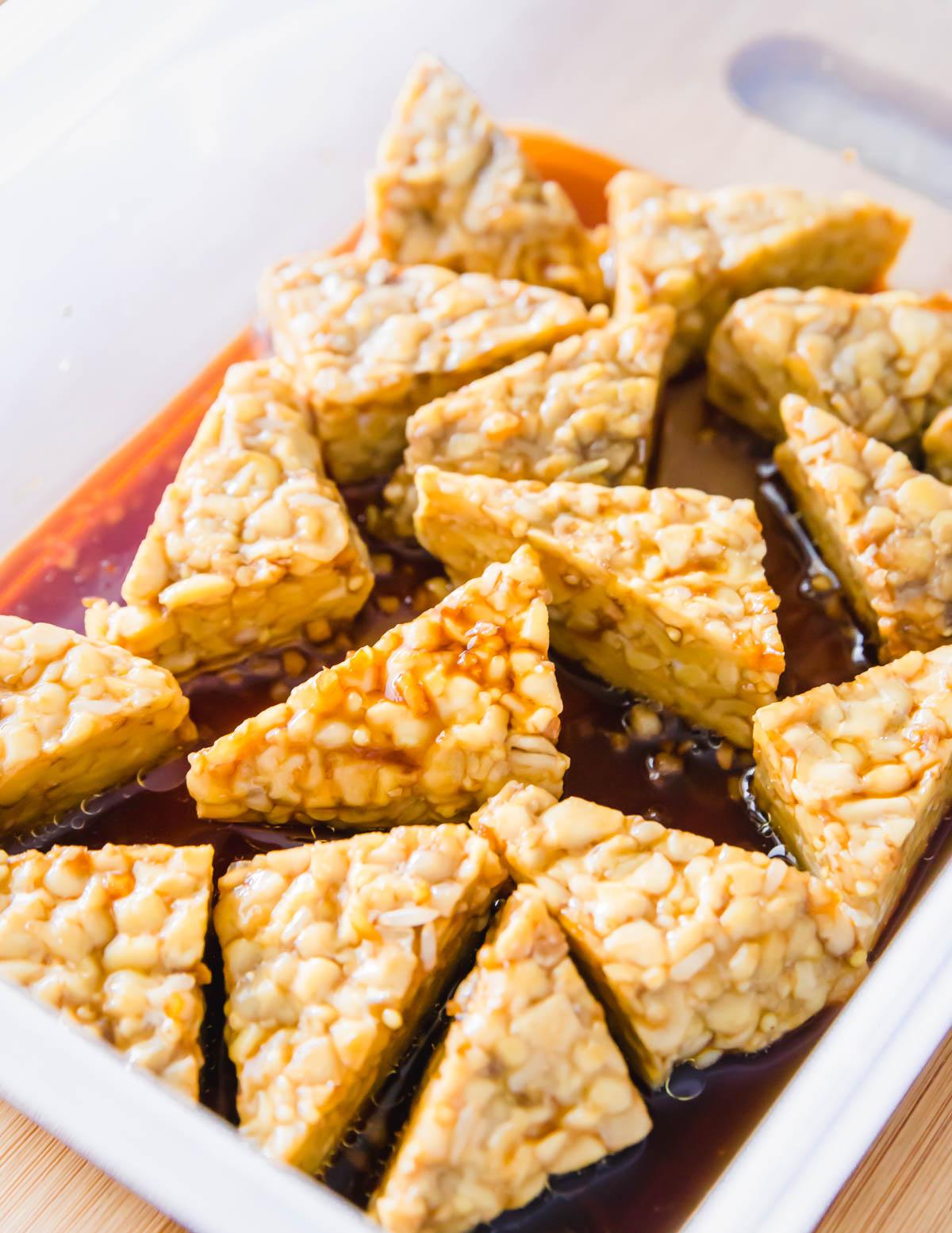 Gluten-free tempeh marinade using tamari, maple syrup, balsamic vinegar, garlic and avocado oil.