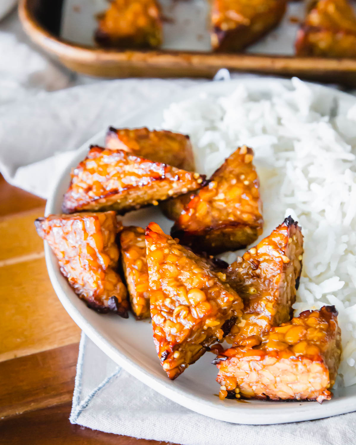 Crispy baked tempeh using a simple marinade for delicious umami flavor.