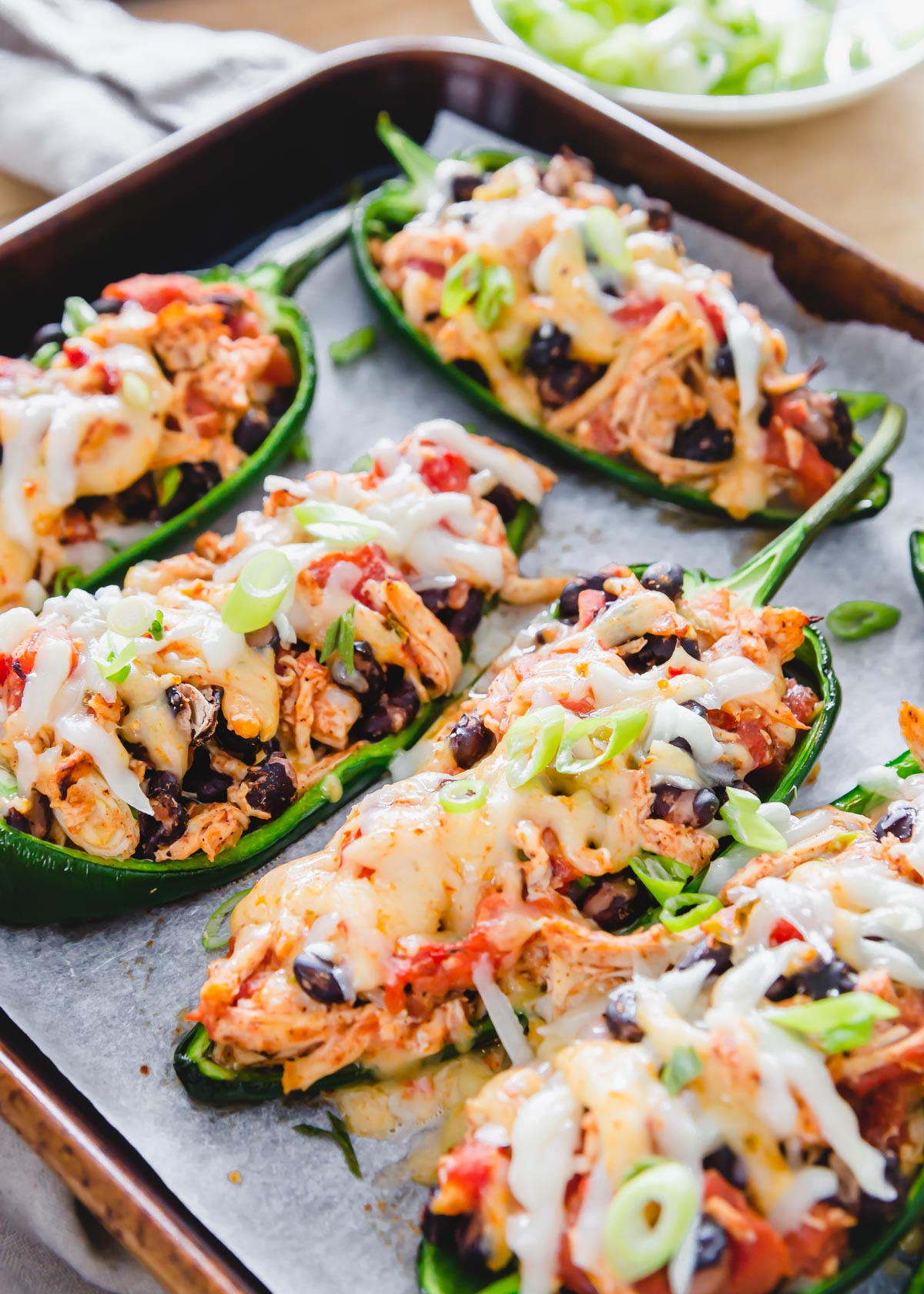 Chicken stuffed poblano peppers are an easy, comforting, low-carb and decadent meal with a Southwestern/Mexican vibe.