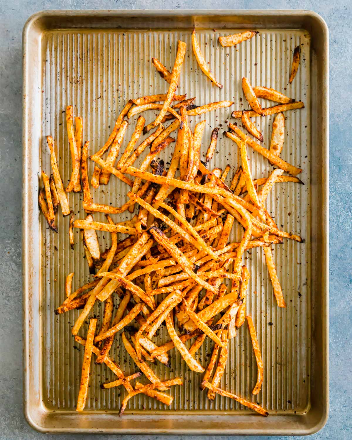 Crispy jicama fry recipe that bakes up easily in the oven in just 25 minutes.