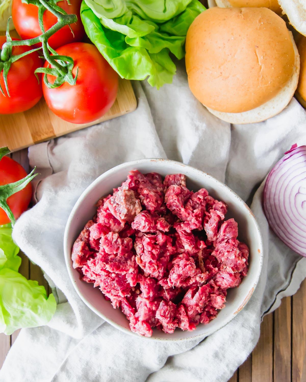 Ground elk meat in a bowl to make elk burgers.