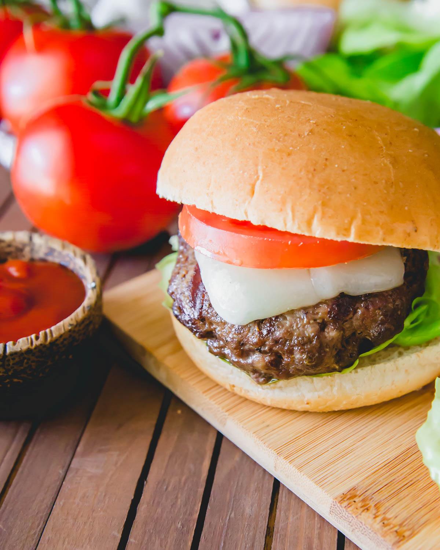 Easy recipe to use up ground wild elk meat in a medium rare juicy elk burger.