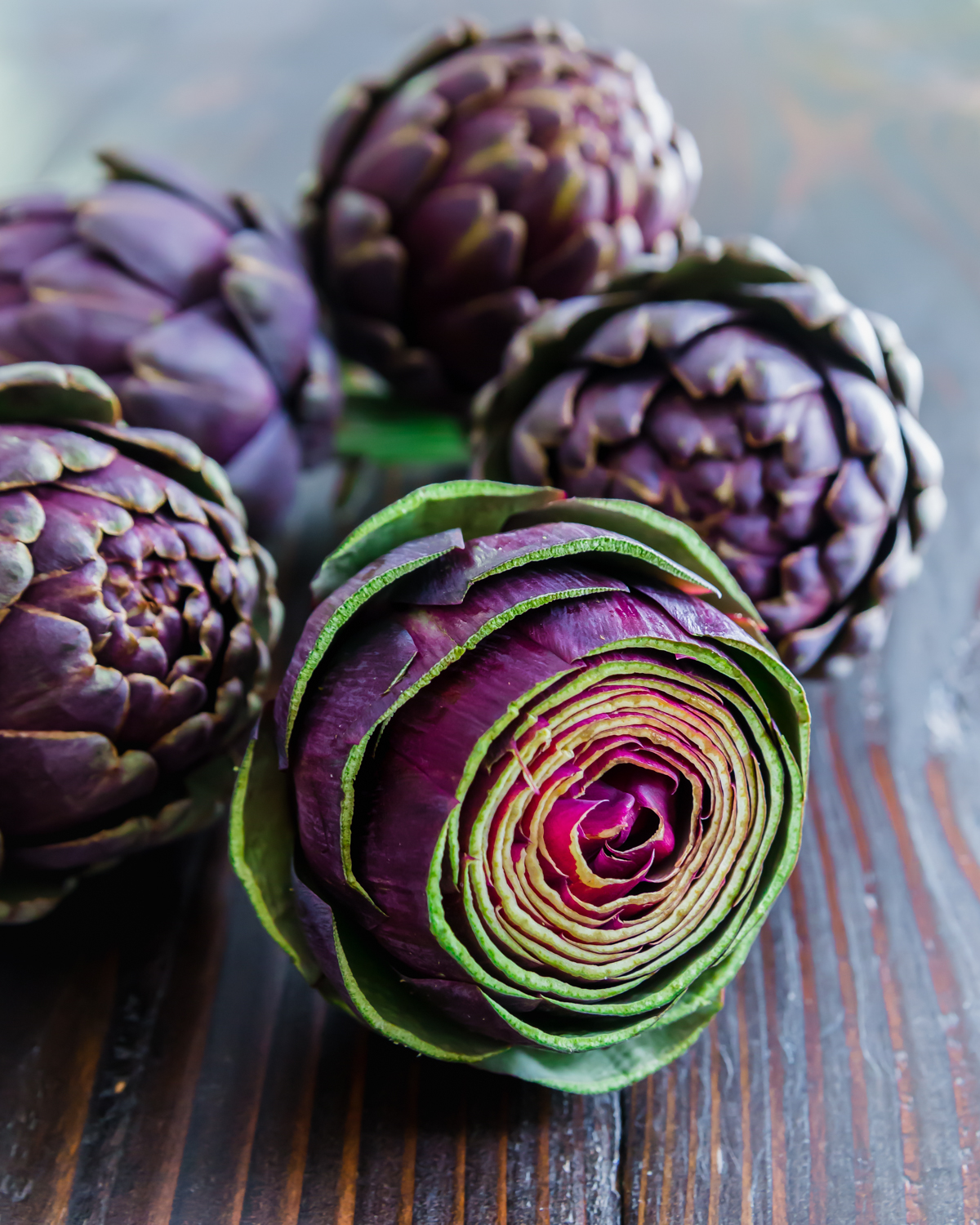 Purple artichokes are a seasonal stunner and make a beautiful addition to this sheet pan sausage and veggies recipe.