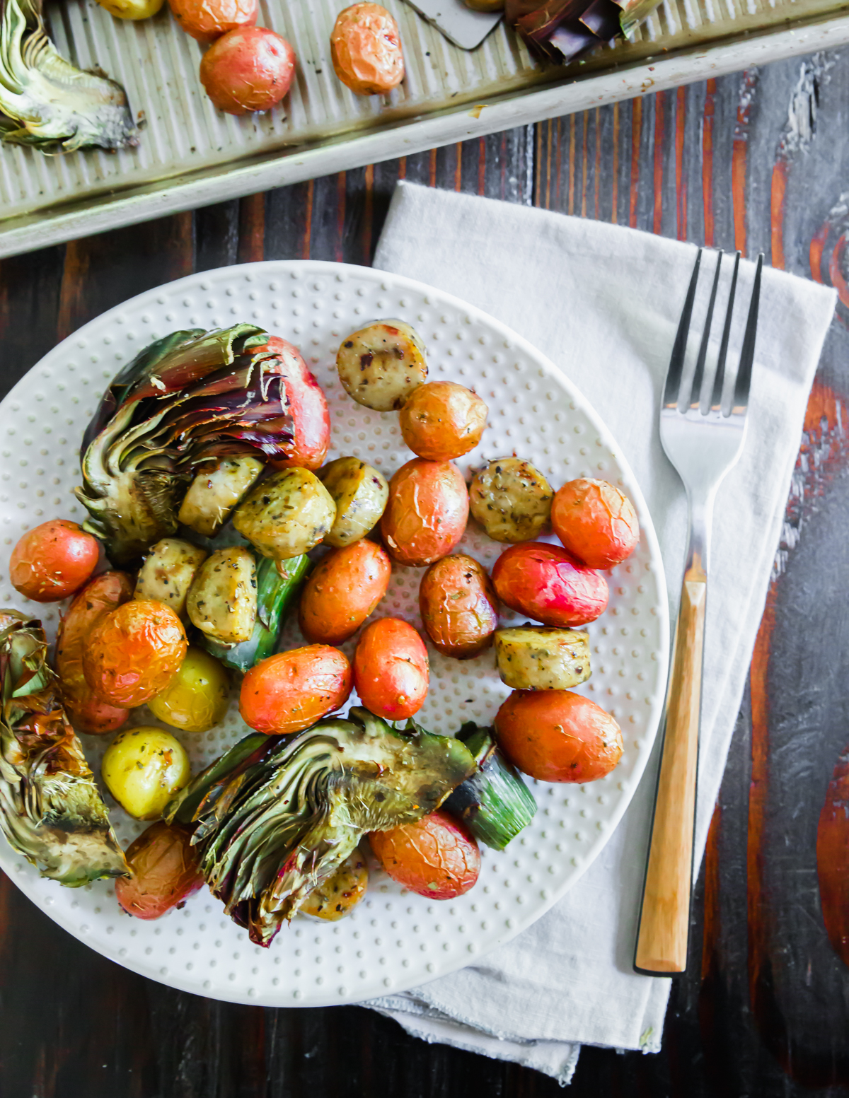 This simple dinner recipe combines sausage and vegetables on a sheet pan for an easy complete meal all in one!