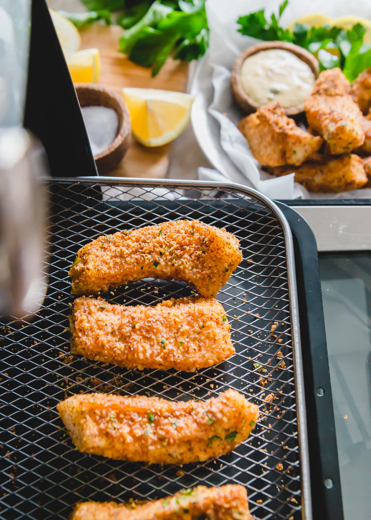After 10 minutes in the air fryer, these cod fish sticks are perfectly crispy on the outside while moist and tender on the inside.