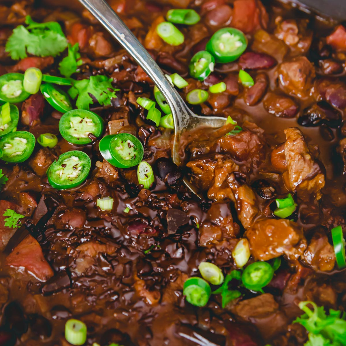 Bittersweet chocolate and cocoa powder add a fun twist to chili in this chocolate lamb chili recipe with a Mexican mole vibe.