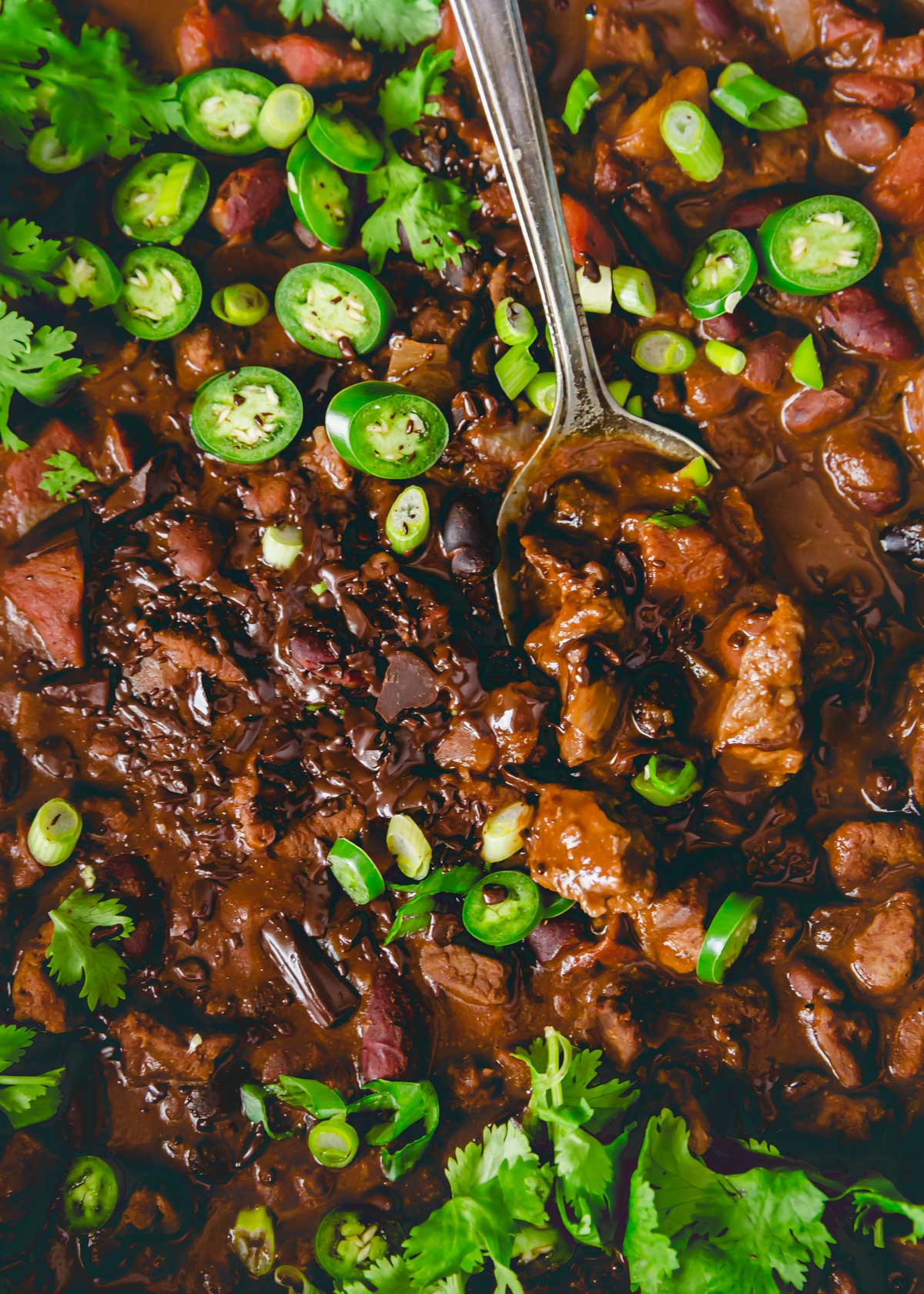 Decadent lamb chili made with cocoa powder and bittersweet chocolate with smoky spices and a mixture of beans.