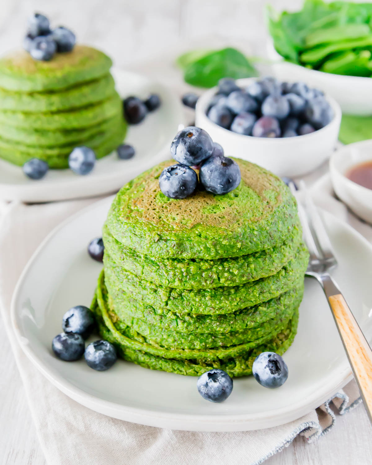 Green pancakes made with fresh spinach have absolutely no food coloring in them for a healthy and festive breakfast!