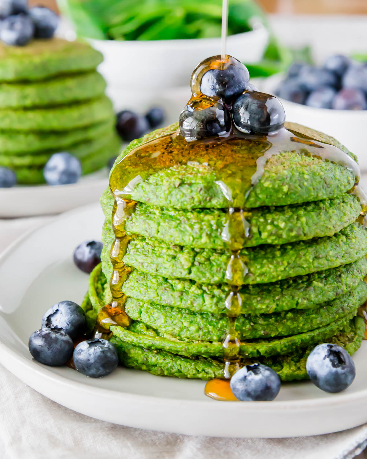 These spinach pancakes are a vivid green color without the use of any food coloring and a simple ingredient list! The perfect St. Patrick's Day breakfast recipe that's also gluten-free & vegan.