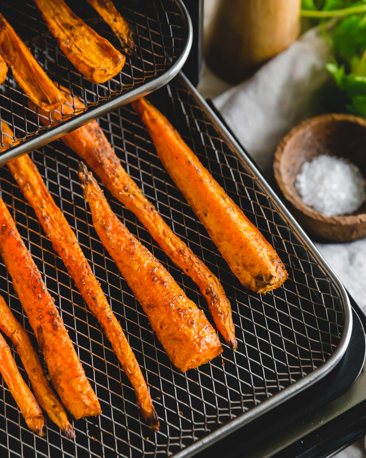 A handful of Moroccan inspired spices and olive oil is all it takes to transform these air fried carrots into a delicious side dish.