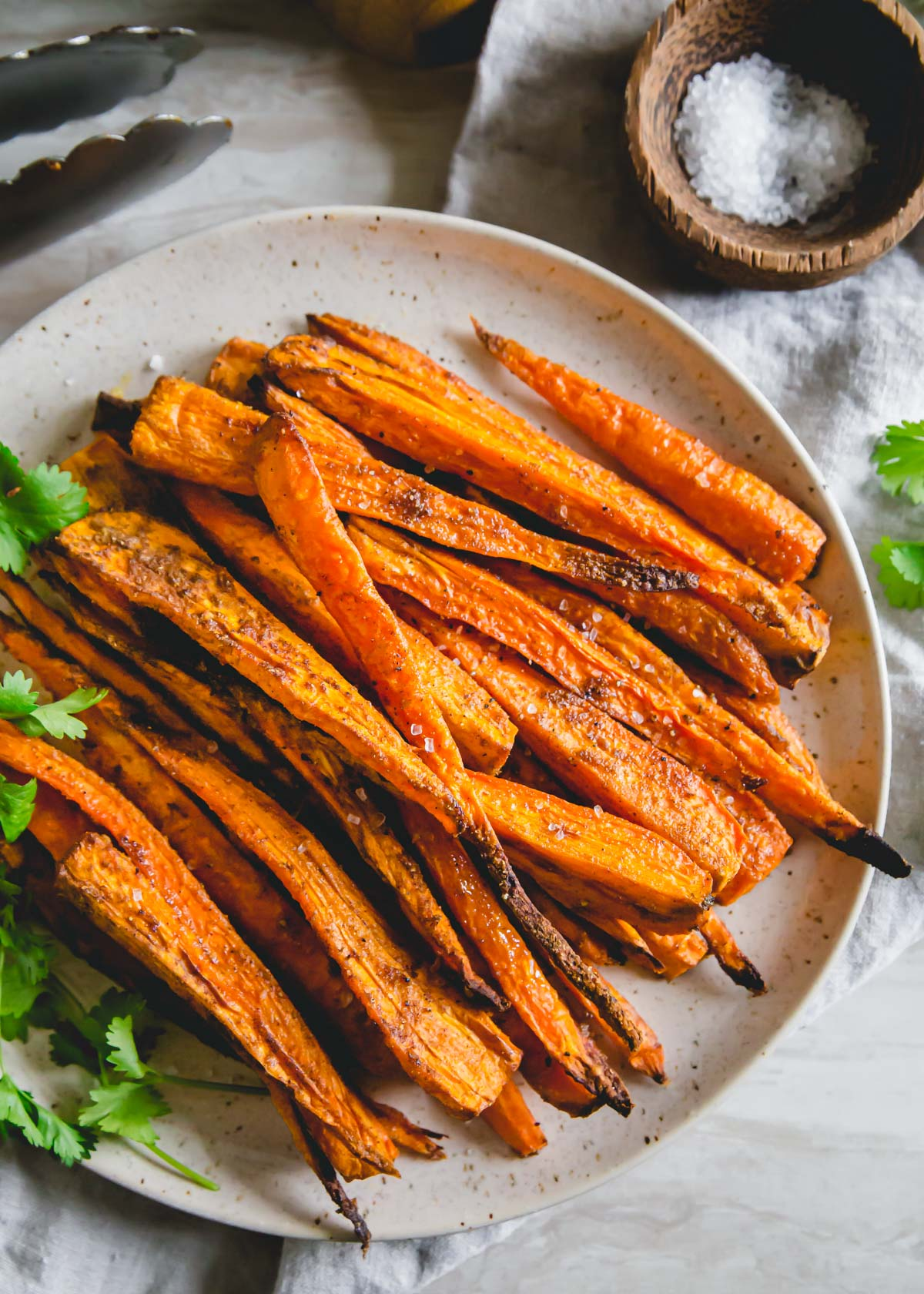 Tender savory spiced air fryer carrots with crispy edges is a simple side dish perfect for any meal made in just 20 minutes.