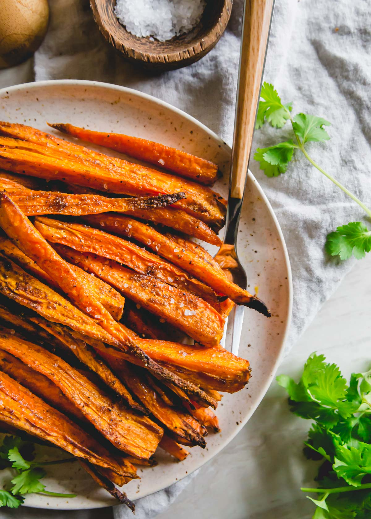 If simple is your goal, these roasted air fryer carrots are the perfect side dish! Just 20 minutes of cooking time and a handful of spices is all you need.