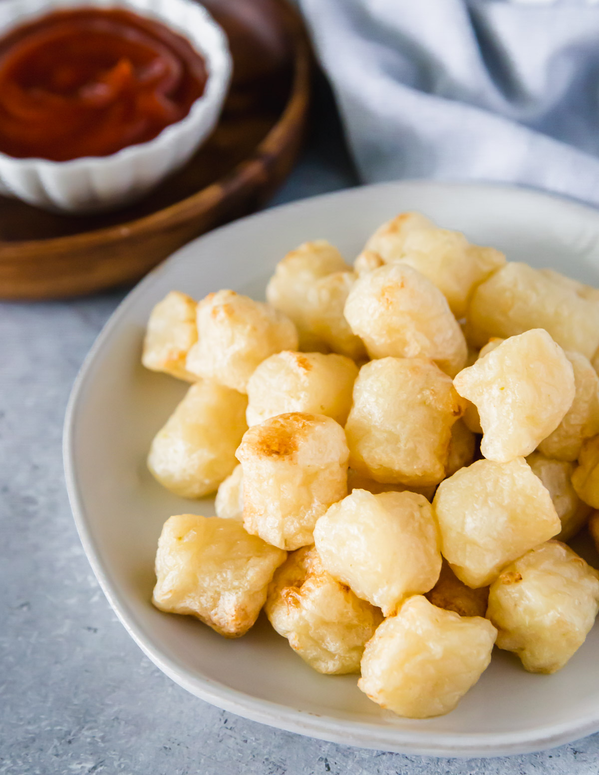 Crispy air fried cauliflower gnocchi can be eaten as an appetizer dipped in your favorite condiment like ketchup.