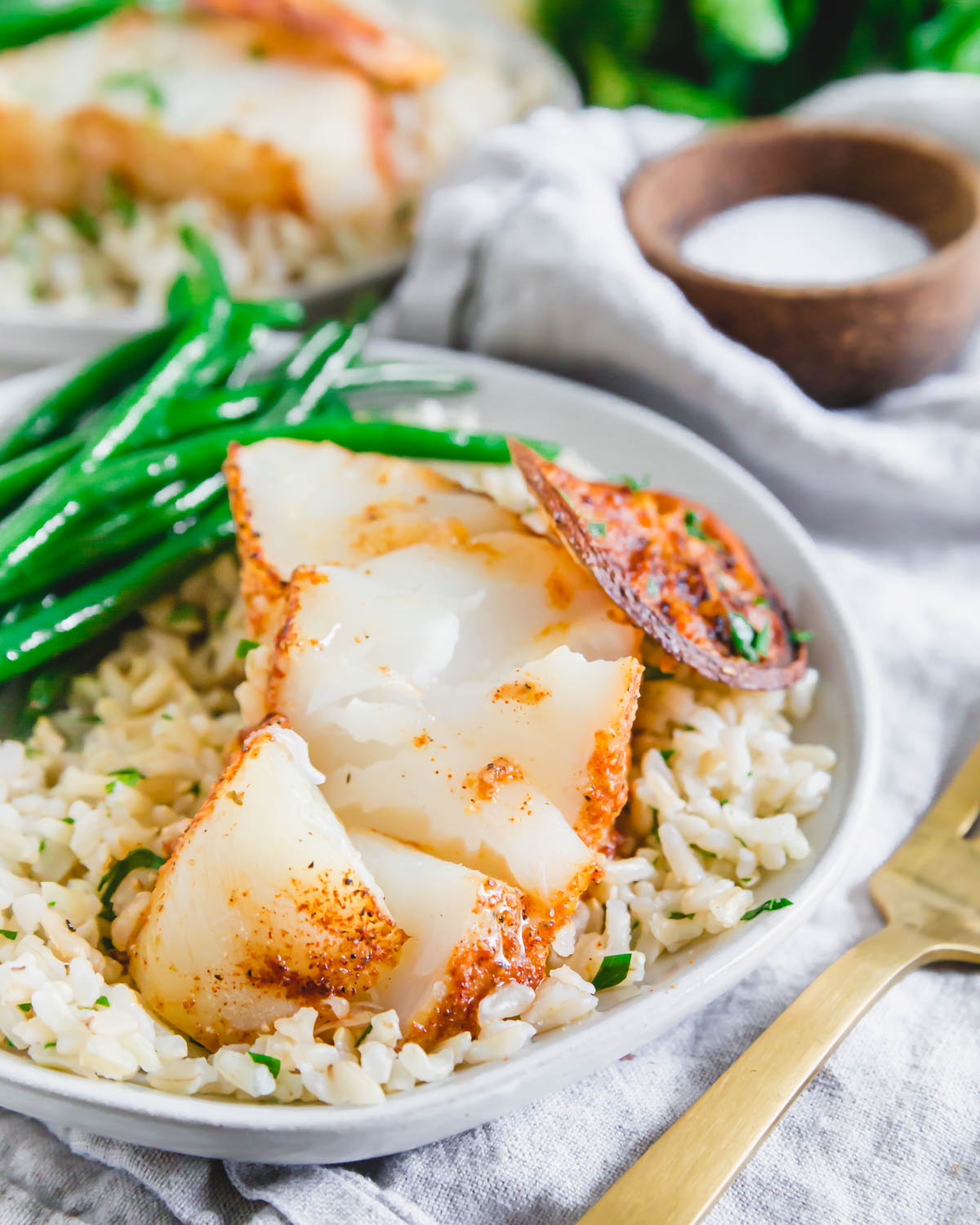 Tender, flaky and delicate cod cooked in the air fryer with just a handful of simple ingredients.