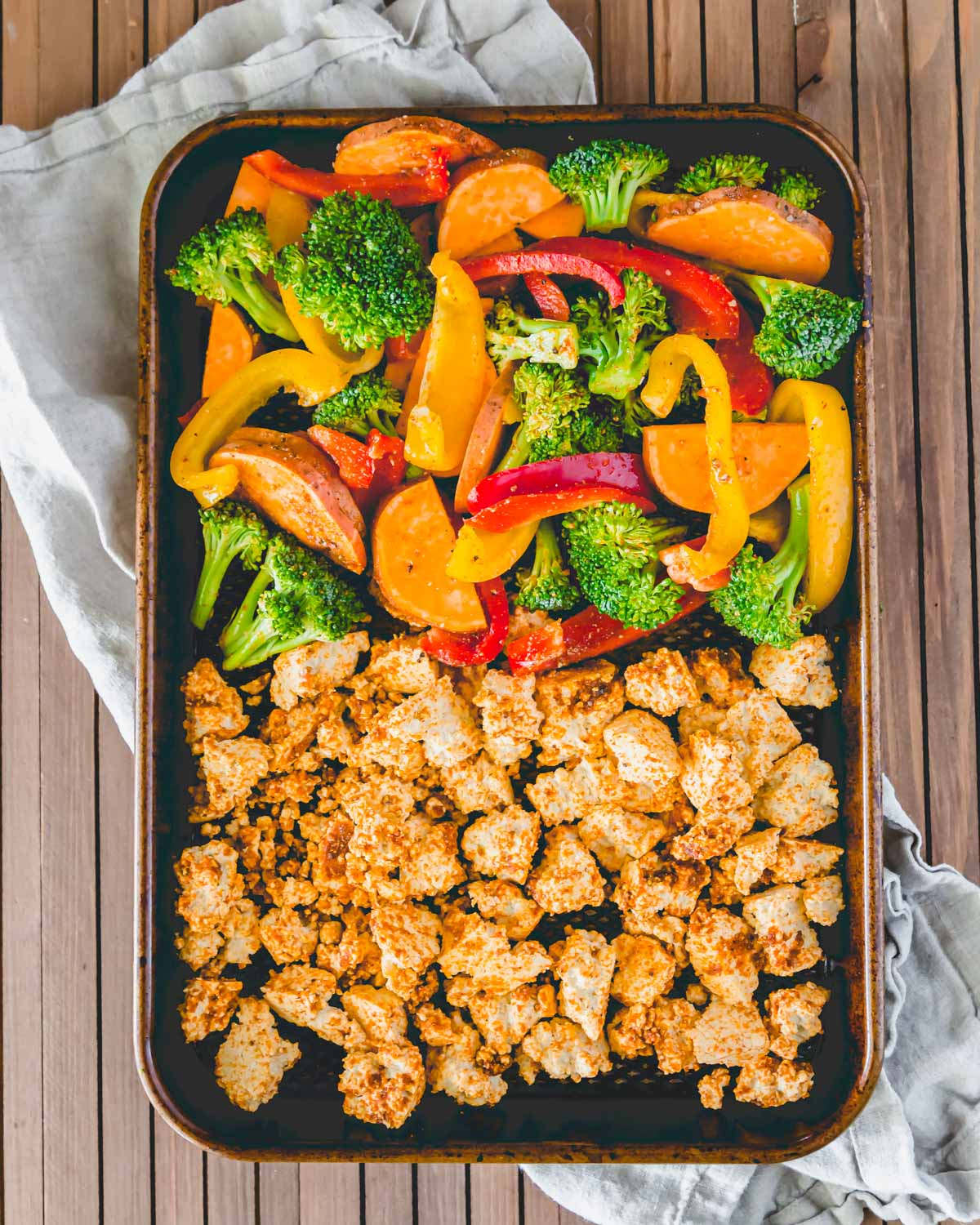 BBQ tofu sheet pan dinner prepped and ready to be baked in the oven.