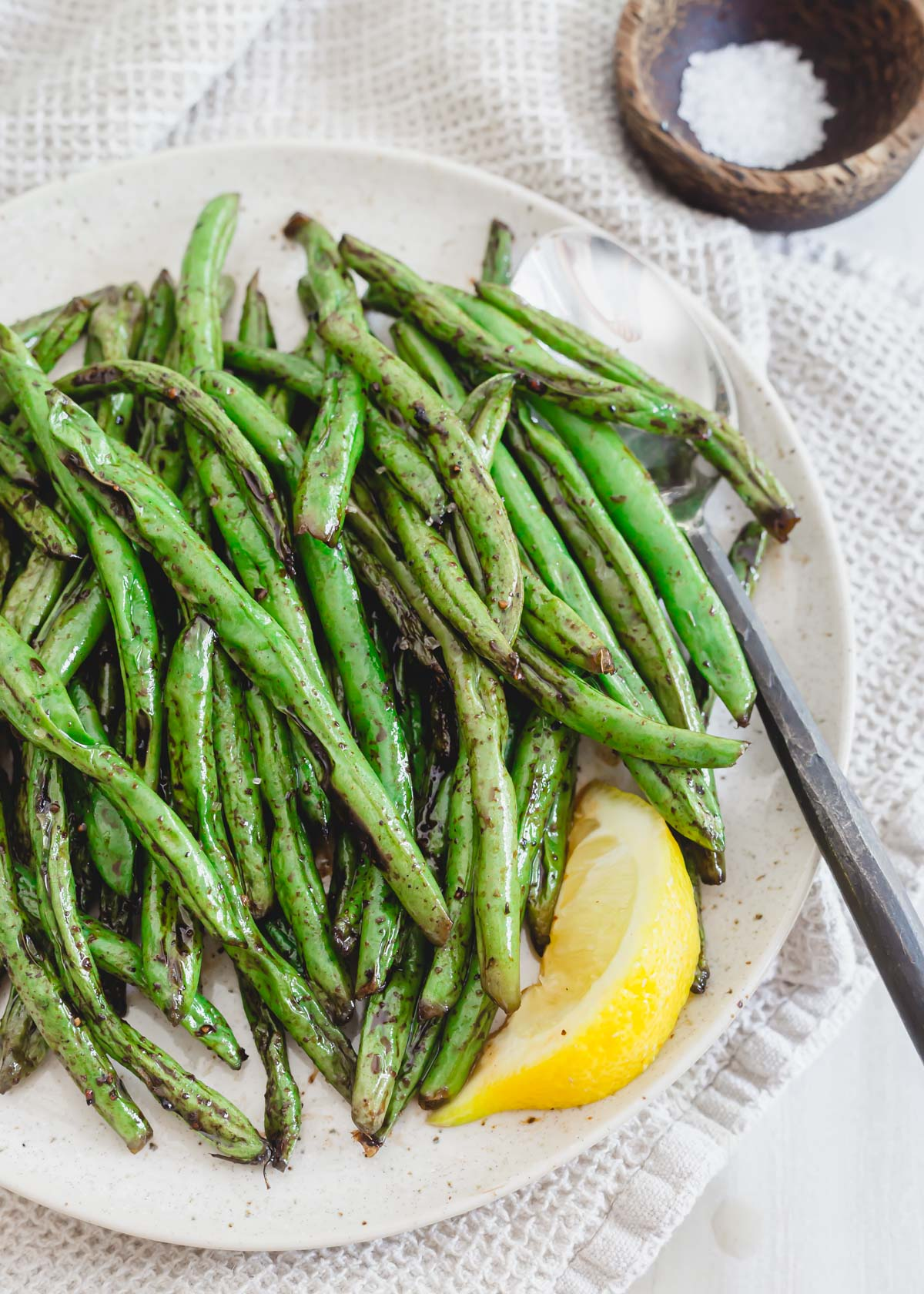 Recipe for how to grill green beans on an outdoor grill.