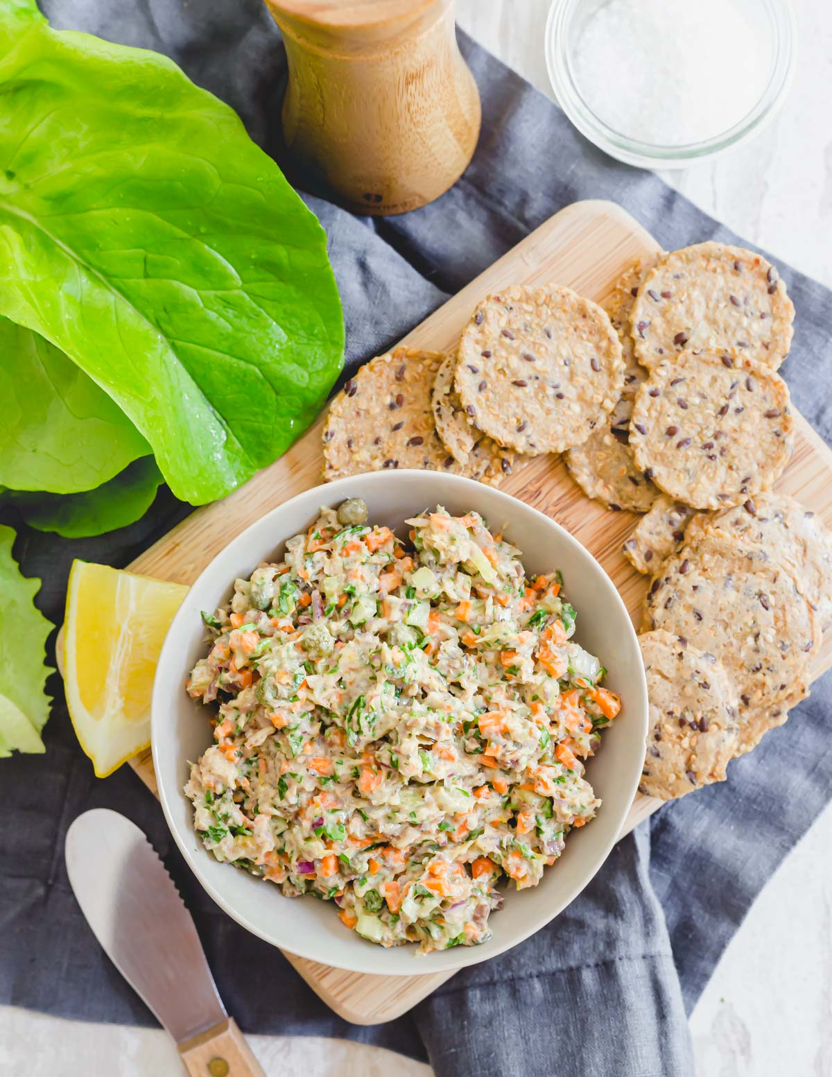 Simple sardine salad recipe in a bowl served with crackers on the side.