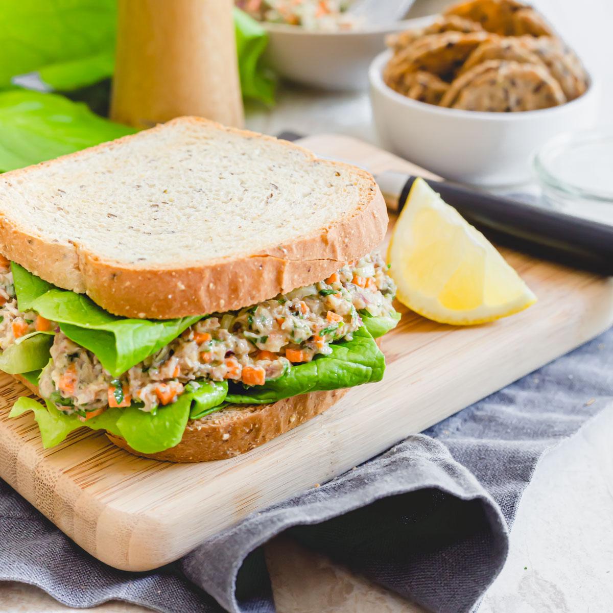 Sardine salad sandwich on gluten-free bread with fresh Bibb lettuce.