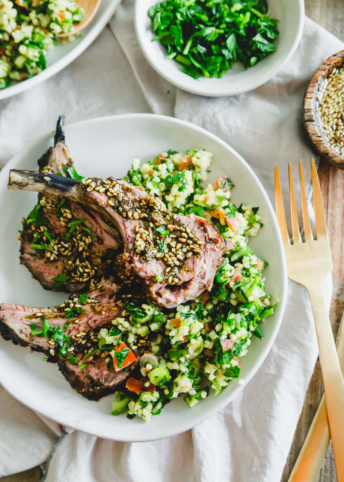 Za'atar seasoned grilled rack of lamb on a bed of gluten-free millet tabbouleh.