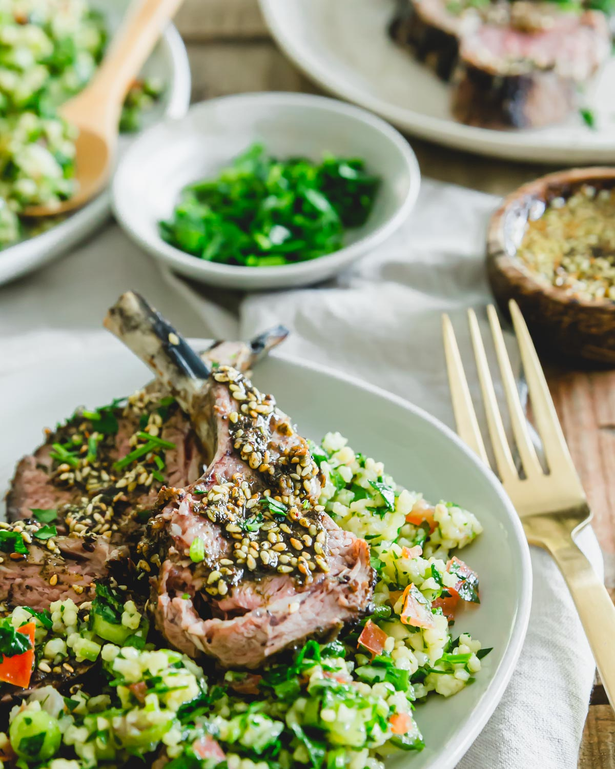 Grilled lamb chop with za'atar paste served with Mediterranean millet tabbouleh.