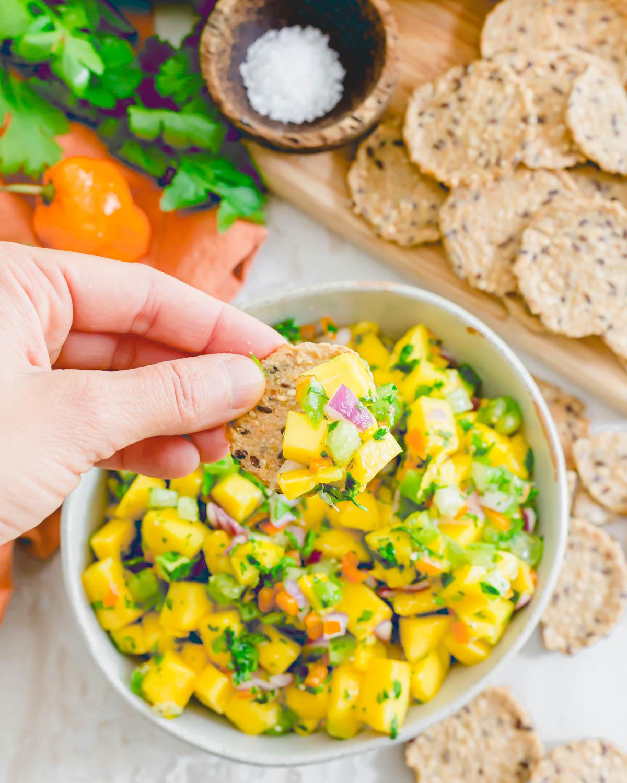 Mango habanero salsa on a cracker.