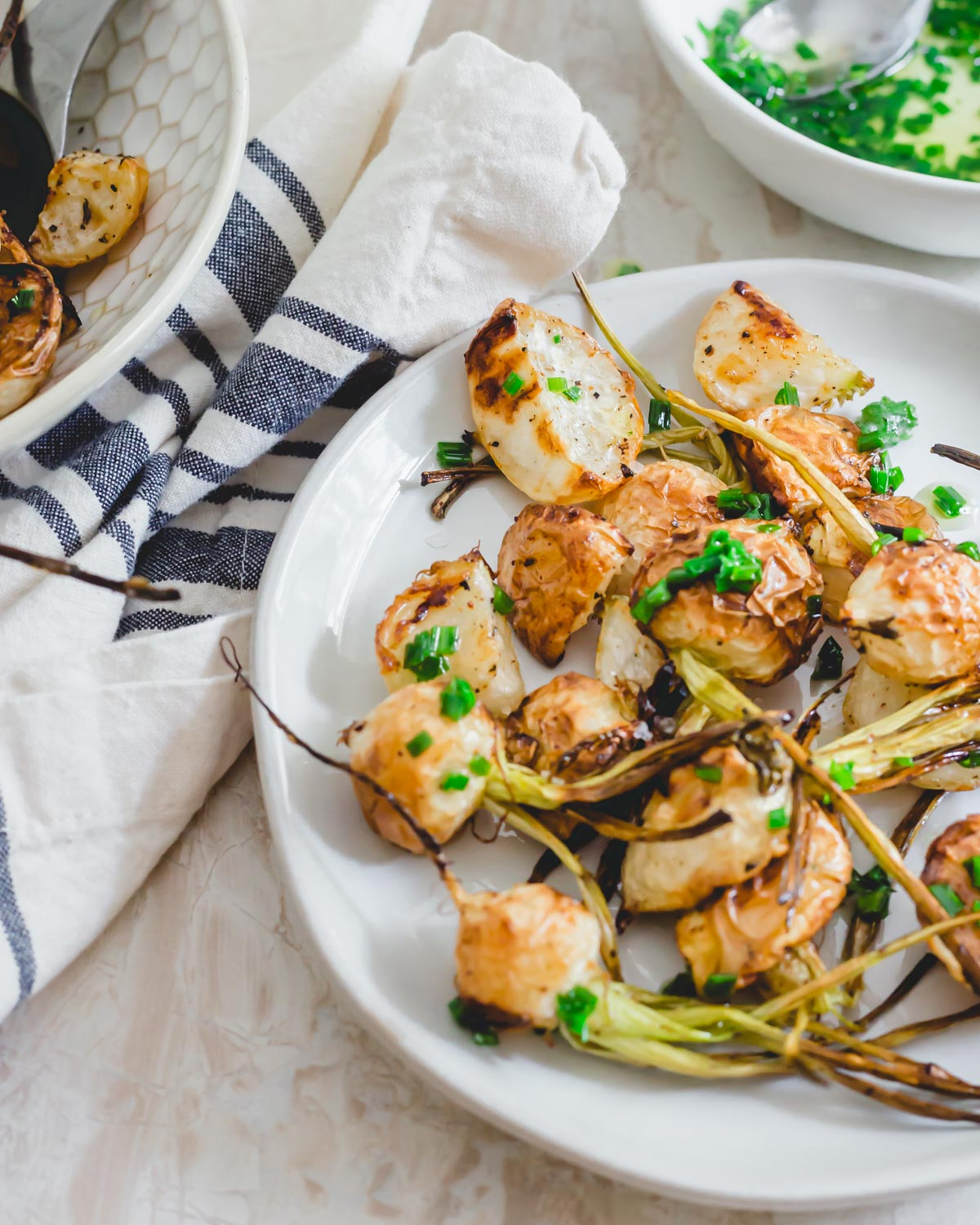 Simple and easy roasted turnip recipe with a chive butter sauce for serving.