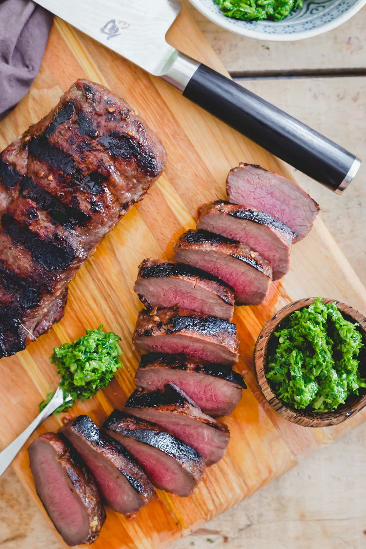 Perfectly grilled venison backstrap sliced and served with a ramp pesto.