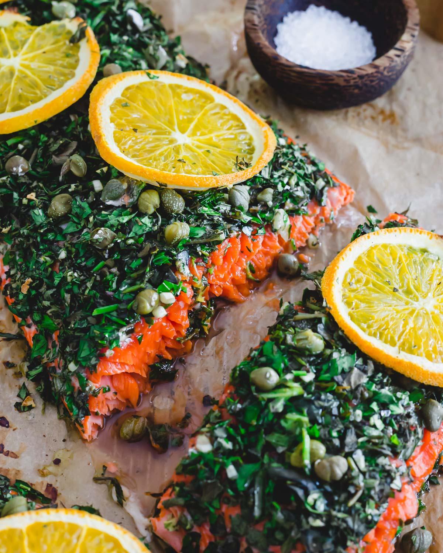 Wild sockeye salmon cut into servings on a baking sheet.