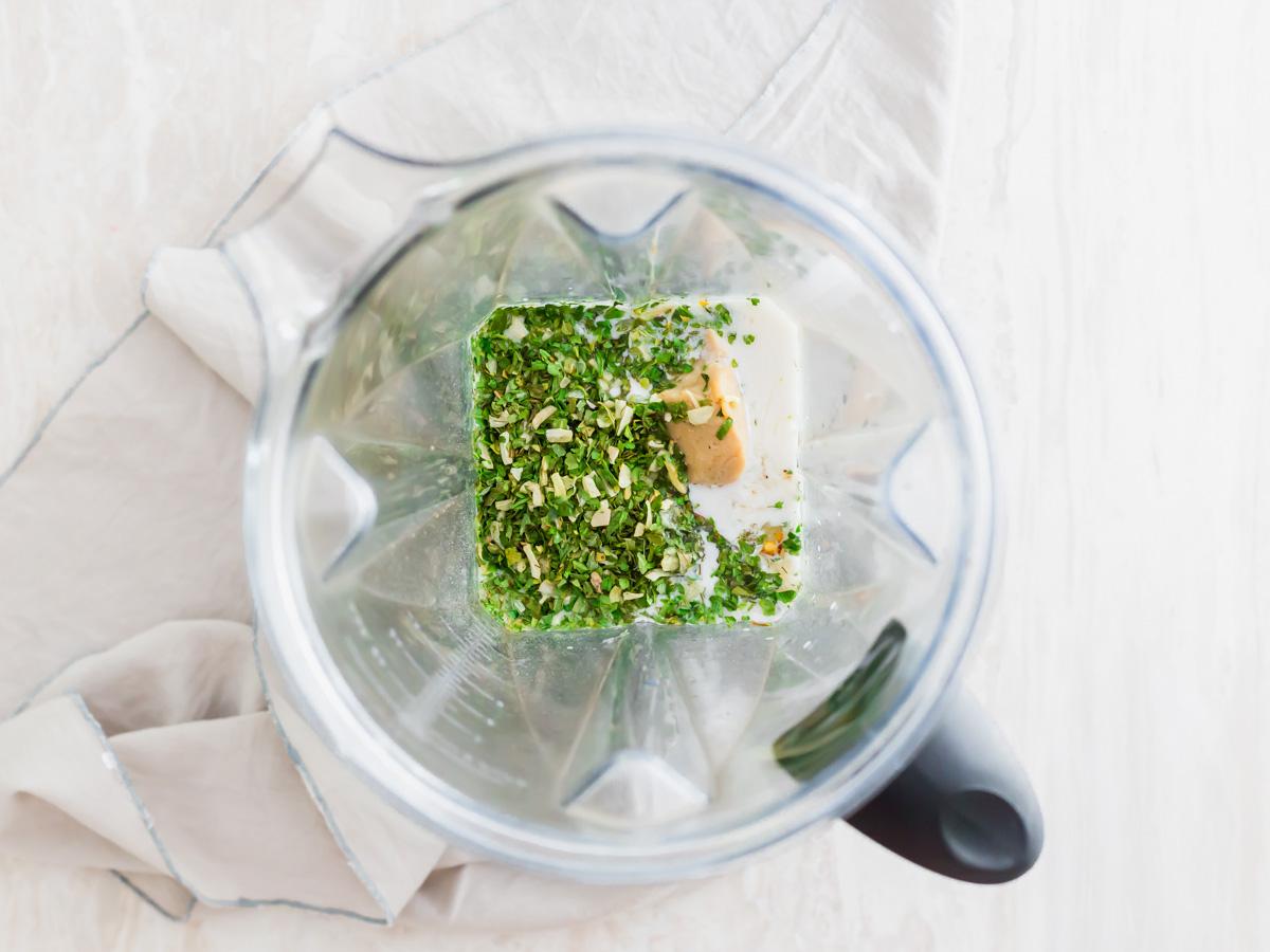 ingredients in blender to make vegan spinach artichoke dip