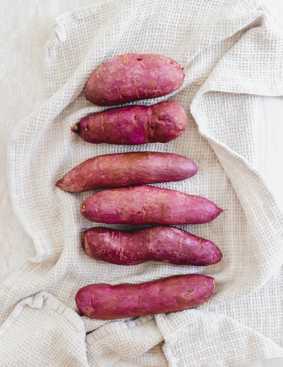 Stokes purple sweet potatoes on a kitchen towel.