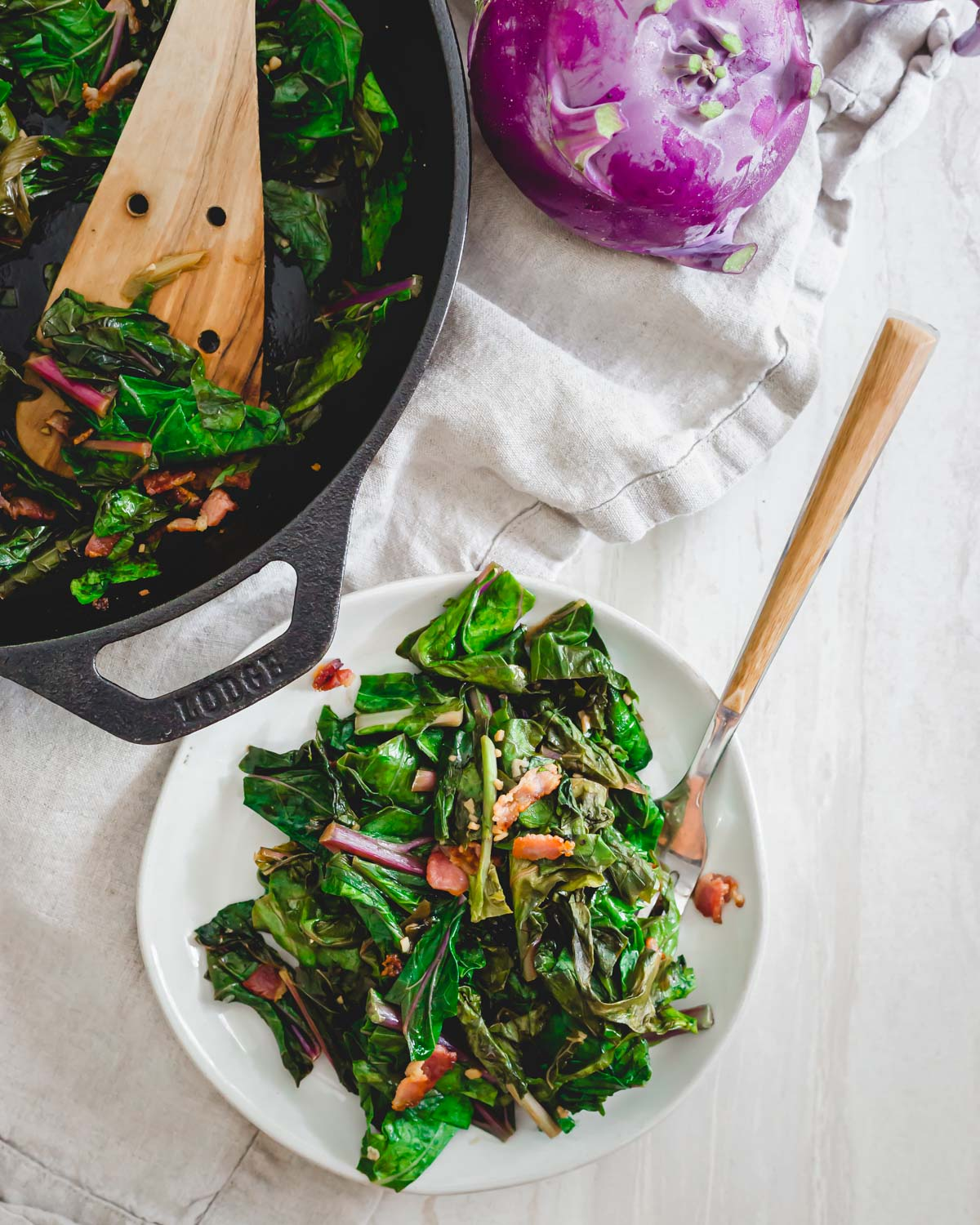 Leafy kohlrabi greens sautéed until tender with garlic, green onions and topped with crispy bacon.