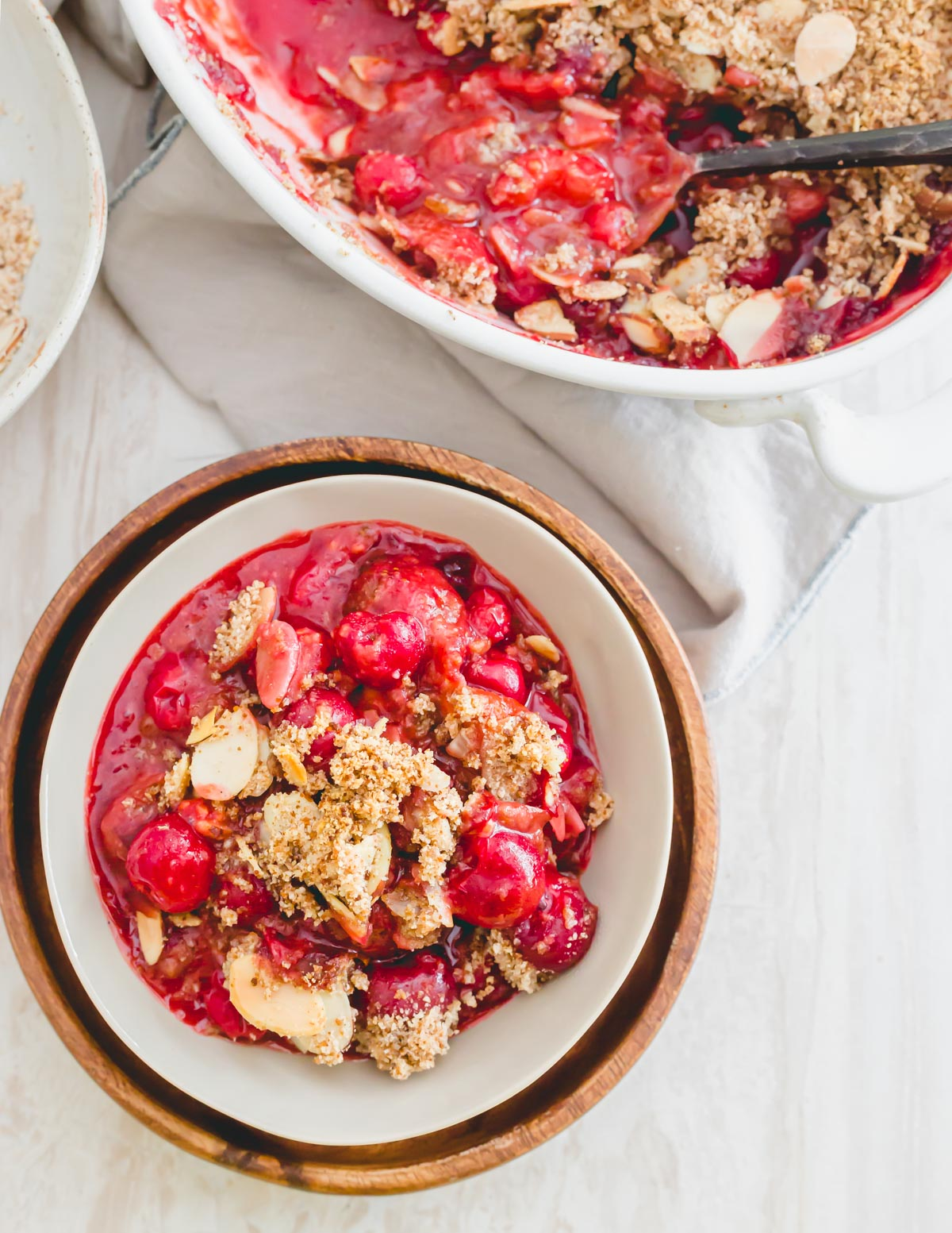 A serving of sour cherry crumble in a small bowl.