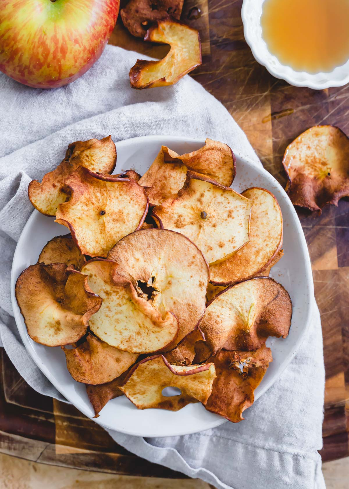 Air fryer apple chips with maple syrup and cinnamon.