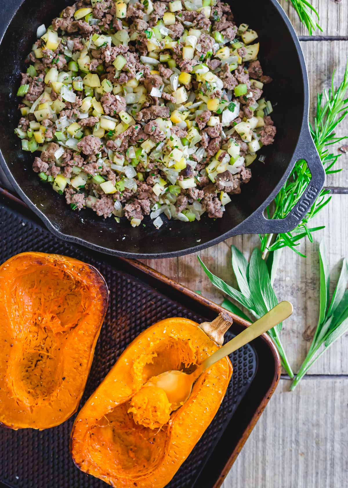 Ground meat with apples, onions, celery and rosemary to stuff roasted honeynut squash.