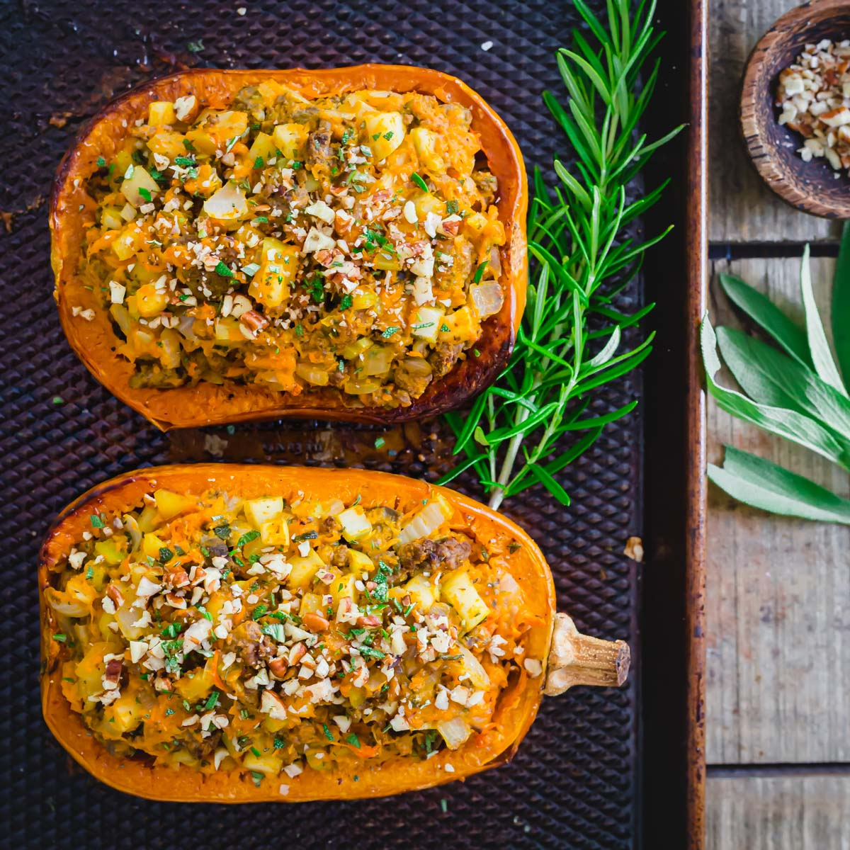 Roasted honeynut squash stuffed with an easy ground meat and rosemary flavored filling.