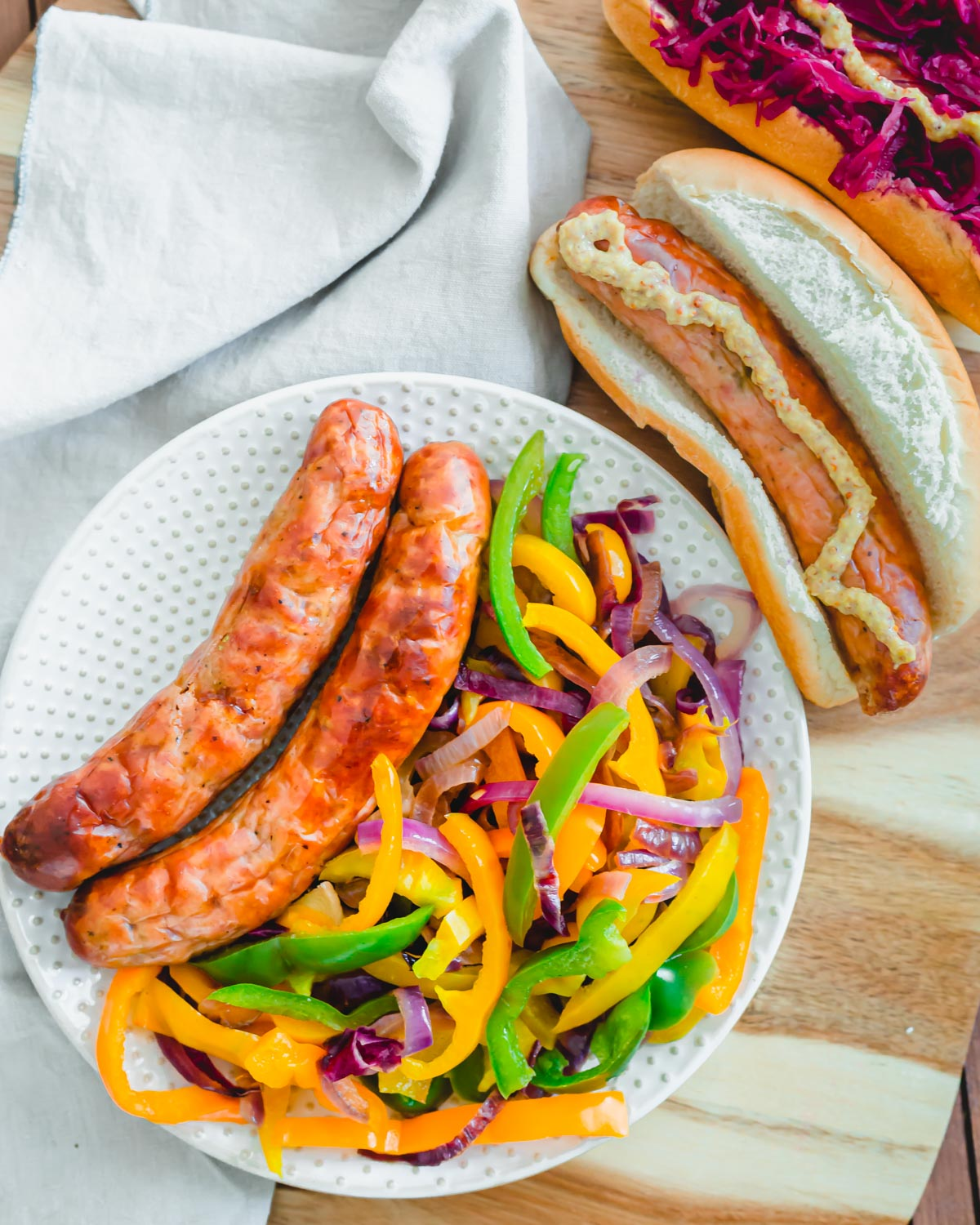 Serve air fried brats with sautéed peppers and onions.