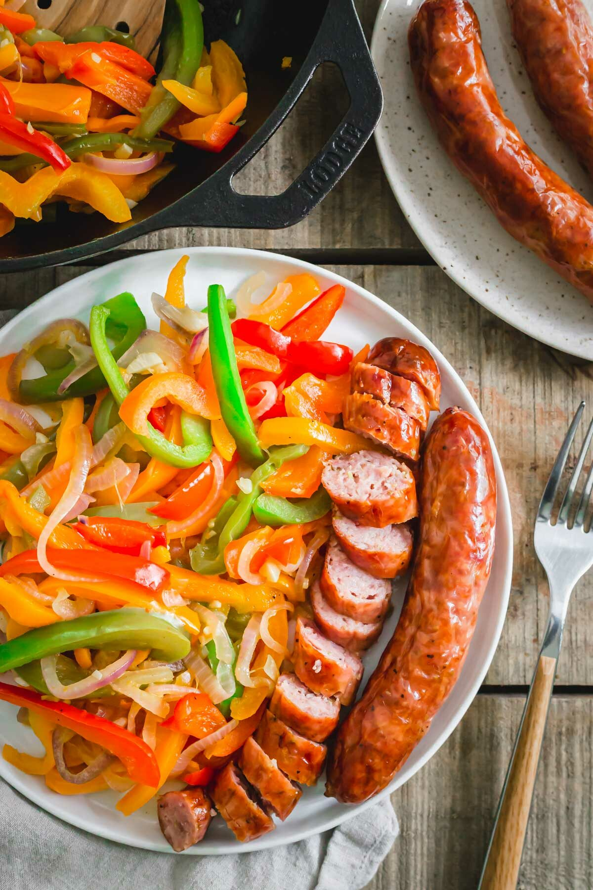Sausage cooked in the air fryer served with peppers, onions and garlic.